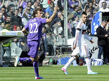 Adem Ljajic of ACF Fiorentina (left) celebrates after scoring his team's first goal from a penalty during their Serie A match against AC Milan at Stadio Artemio Franchi in Florence on Sunday