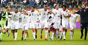 Bayern Munich's players celebrate after winning their German Bundesliga match against Eintracht Frankfurt and the German League title in Frankfurt on Sunday