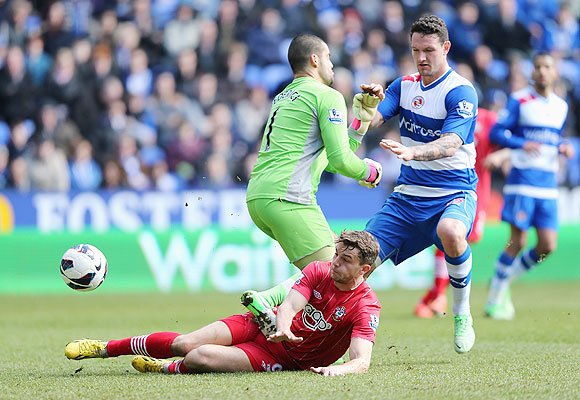Jay Rodriguez of Southampton scores the opening goal past 'keeper Adam Federici of Reading during their EPL match at the Madejski Stadium on Saturday