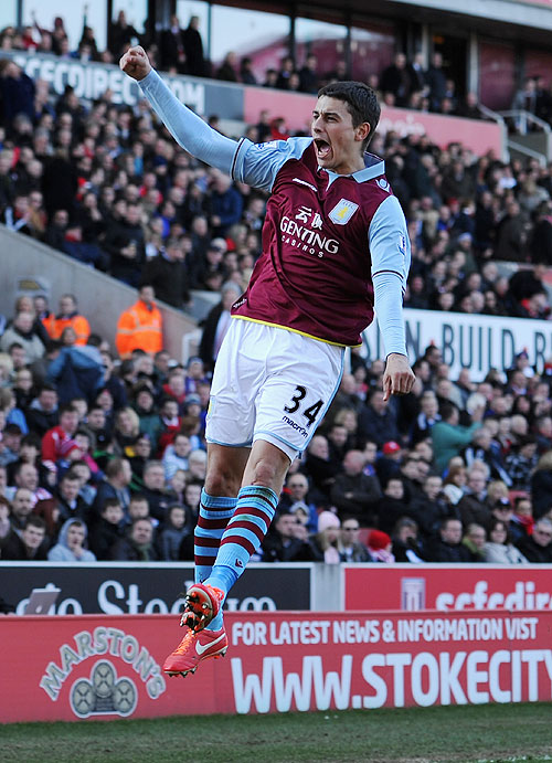 Matthew Lowton of Aston Villa celebrates scoring his team's second goal against Stoke City at the Britannia Stadium Saturday