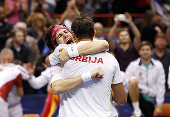 Serbia's Ilija Bozoljac (left) and Nenad Zimonjic celebrate after defeating United States' Mike Bryan and Bob Bryan during their Davis Cup doubles quarter-final match in Boise, Idaho, on Saturday