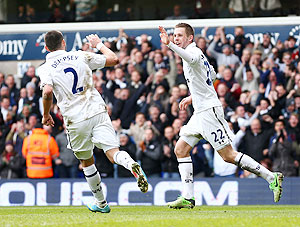 Gylfi Sigurdsson of Tottenham Hotspur celebrates with teammate Clint Dempsey after scoring against Everton at White Hart Lane on Sunday