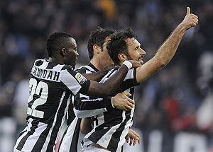 Juventus' Mirko Vucinic (right) celebrates with teammates after scoring against Pescara during their Serie A match at the Juventus stadium in Turin on Saturday