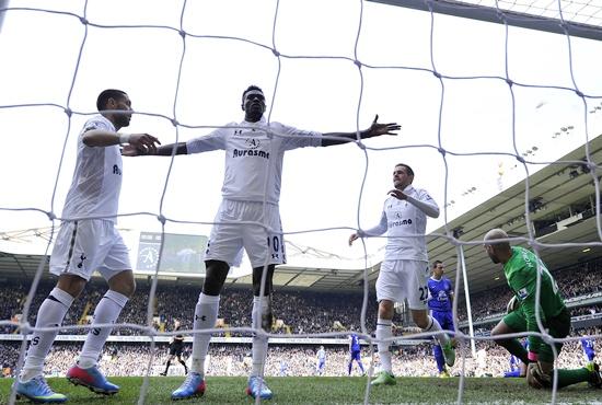 Tottenham Hotspur's Emmanuel Adebayor (second left) is congratulated by teammates