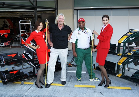 Sir Richard Branson of Virgin GP and Tony Fernandes of Lotus in the paddock before qualifying for the Abu Dhabi F1 GPon November 13, 2010
