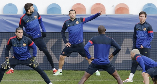 Barcelona's players including Lionel Messi (right) attend a training   session