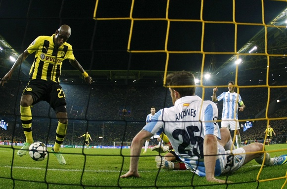 Borussia Dortmund's Felipe Santana (left) scores a third and winning goal