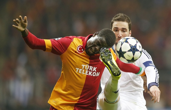 Galatasaray's Emmanuel Eboue (left) is challenged by Real Madrid's Raphael Varane