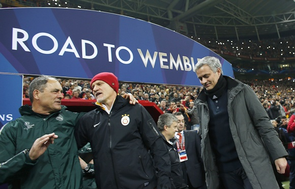 Real Madrid's coach Jose Mourinho (right) walks off
