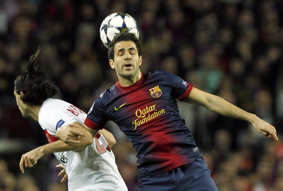 Barcelona's Cesc Fabregas (left) and Paris St Germain's Javier Pastore