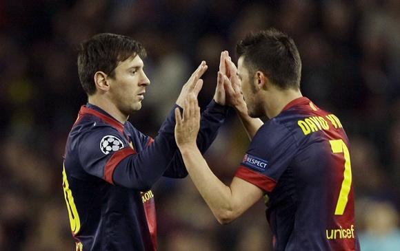 Barcelona's Lionel Messi (left) and David Villa celebrate