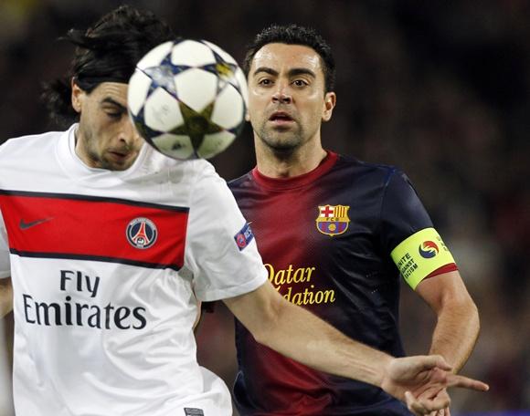 Barcelona's Xavi (right) and Paris St Germain's Javier Pastore