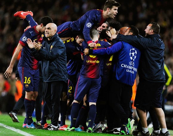 Gerard Pique of Barcelona jumps on his team mates