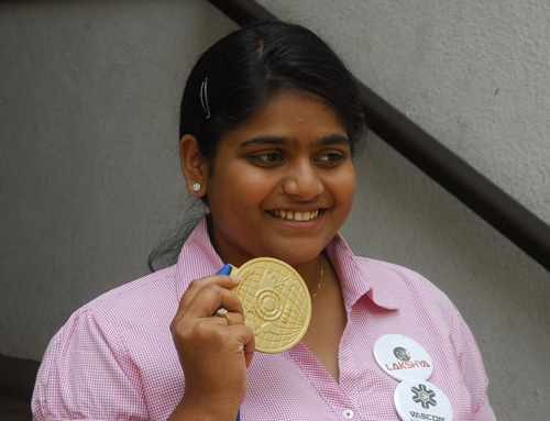 Rahi Sarnobat shows off her medal in Mumbai on Thursday