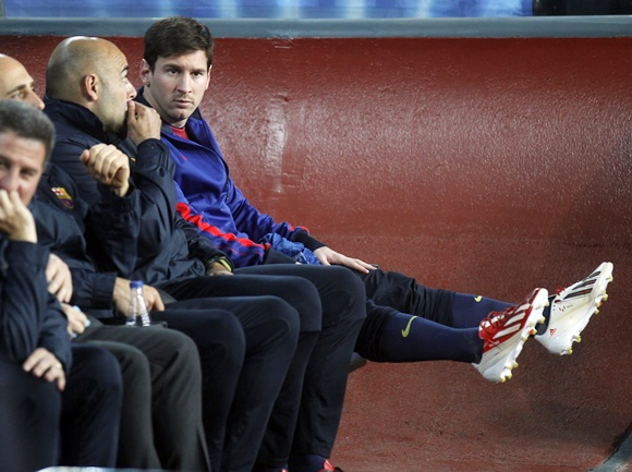 Barcelona's Lionel Messi sits on the bench