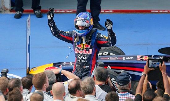 Red Bull Formula One driver Sebastian Vettel celebrates