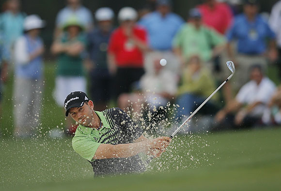 Sergio Garcia of Spain hits from a sand trap on the 17th green during first round play in the 2013 Masters golf tournament at the Augusta National Golf Club in Augusta, Georgia, on Thursday