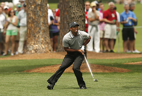 Tiger Woods of the U.S. watches his approach shot to the seventh green during first round play in the 2013 Masters golf tournament at the Augusta National Golf Club in Augusta, Georgia on Thursday