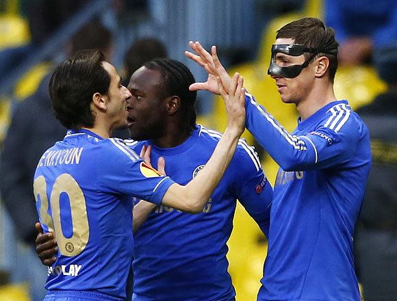 Chelsea's Fernando Torres (right) celebrates his goal with teammates Victor Moses (centre) and Yossi Benayoun during their Europa League quarter-final second leg match against Rubin Kazan at the Luzhniki stadium in Moscow on Thursday