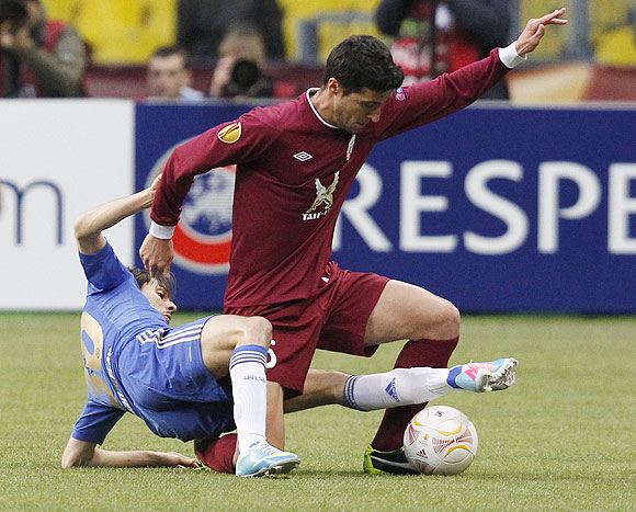 Rubin Kazan's Ivan Marcano (right) is challenged by Chelsea's Yossi Benayoun during their Europa League quarter-final second leg match at the Luzhniki stadium in Moscow on Thursday