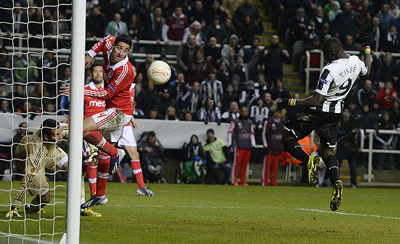 Newcastle United's Papiss Cisse (right) heads to score during their Europa League quarter-final match against Benfica in Newcastle, on Thursday