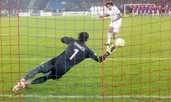 FC Basel's goalkeeper Yann Sommer makes a valiant save to deny Tottenham Hotspur's Tom Huddlestone (right) from scoring of a penalty during their Europa League quarter-final second leg match in Basel on Thursday