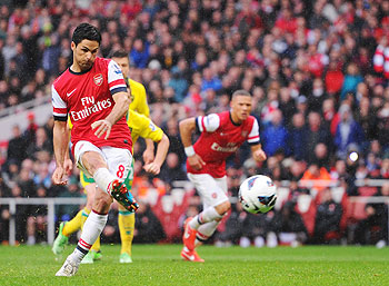 Mikel Arteta of Arsenal scores a goal off a free-kick during their match against Norwich City at Emirates Stadium on Saturday