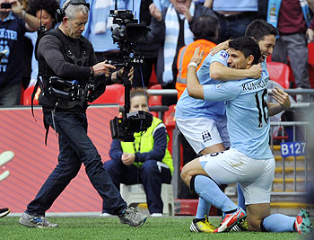 Manchester City's Sergio Aguero (right) celebrates scoring against Chelsea with teammate Samir Nasri during their FA Cup semi-final soccer match at Wembley Stadium in London on Sunday
