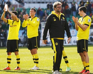 Juergen Klopp, coach of Borussia Dortmund, celebrates with his players