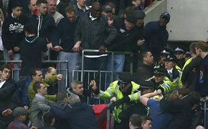 Millwall fans fight with police officers