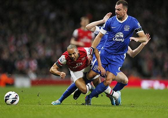 Arsenal's Theo Walcott (left) is fouled by Everton's Darron Gibson during their English Premier League match on Tuesday