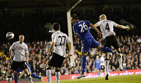 Chelsea's John Terry (2nd from right) scores past Fulham's Brede Hangeland, Sascha Riether and Philippe Senderos (left to right) during their English Premier League match at Craven Cottage on Wednesday