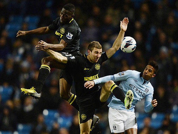 Wigan Athletic's Maynor Figueroa (left) and James McCarthy (2nd from left) challenge Manchester City's Scott Sinclair during their English Premier League match on Wednesday
