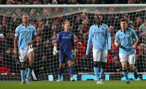 Manchester City players react after losing a match