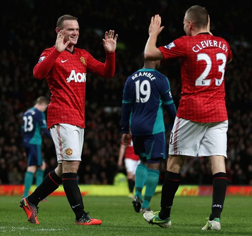 Wayne Rooney of Manchester United is congratulated by Tom Cleverley