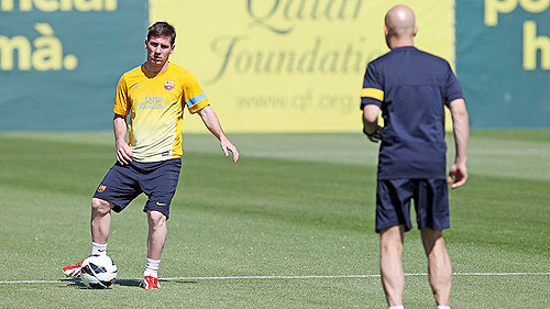 Lionel Messi goes through the grind at a training camp on Thursday