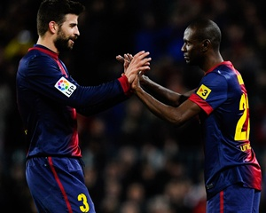 Eric Abidal of FC Barcelona comes on for Gerard Pique