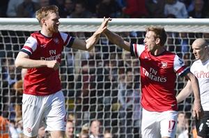 Arsenal's Per Mertesacker (left) celebrates scoring against Fulham with teammate Nacho Monreal