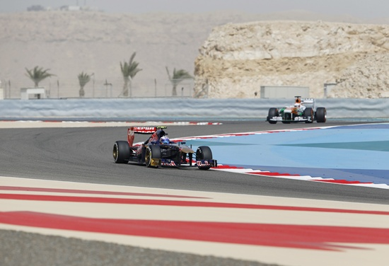 Toro Rosso Formula One driver Daniel Ricciardo of Australia (front) drives in front of Force India driver Paul di Resta