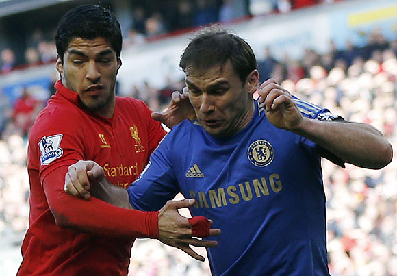 Chelsea's Branislav Ivanovic (right) challenges Liverpool's Luis Suarez during their English Premier League soccer match at Anfield in Liverpoolon Sunday
