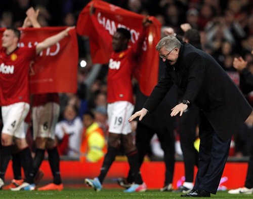 Manchester United's manager Alex Ferguson celebrates after his   team clinched the English Premier League title on Monday