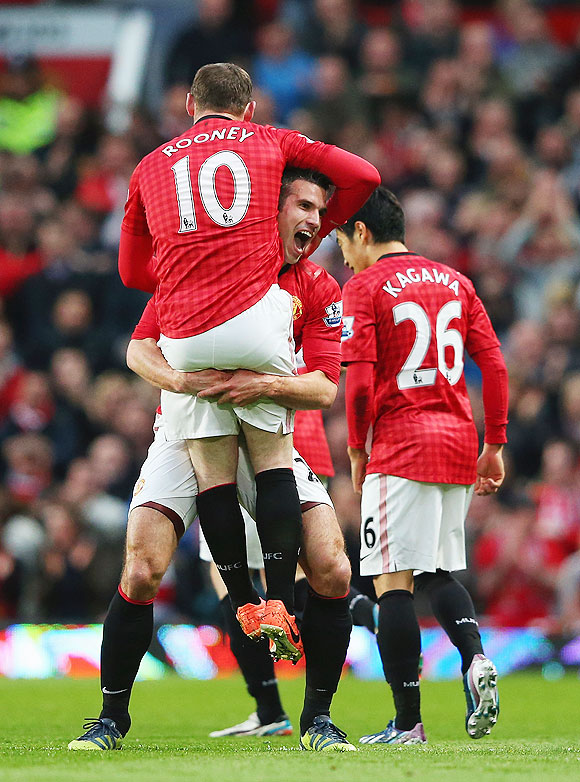 Manchester United's Robin van Persie celebrates with Wayne Rooney after scoring against Aston Villa on Monday