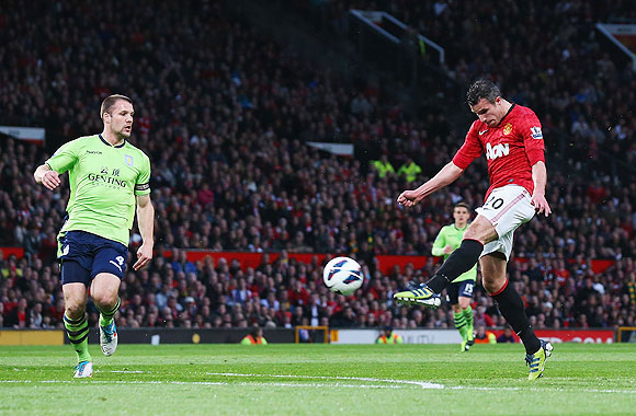 Manchester United's Robin van Persie scores his team's second goal against Aston Villa at Old Trafford on Monday