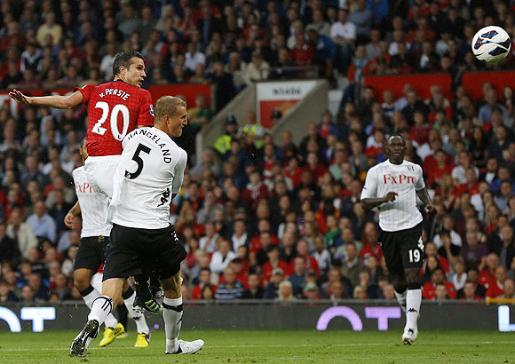 Robin van Persie heads to score Manchester United's opening goal against Fulham in August 2012