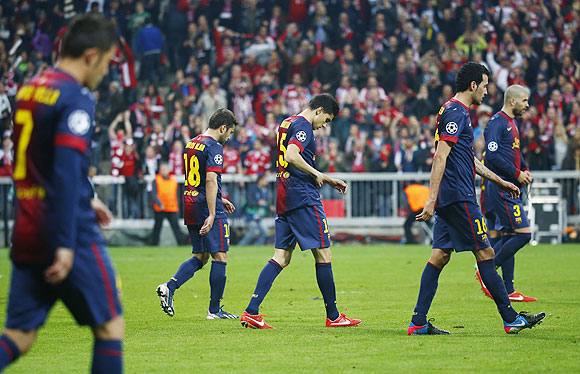Barcelona's players react after losing 4-0 against Bayern Munich on Tuesday