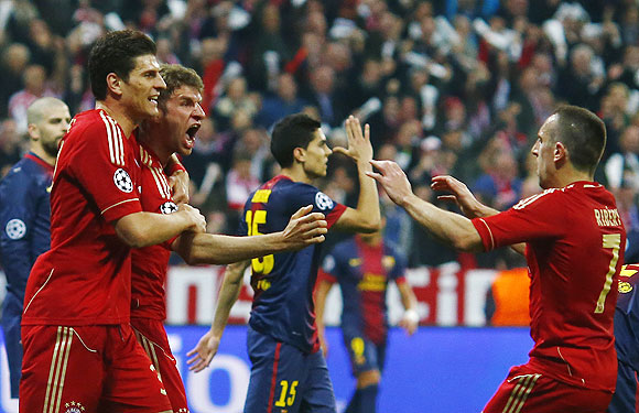 Bayern Munich's Thomas Muller (2nd from left) celebrates with teammates Franck Ribery (right), and Mario Gomez after scoring against Barcelona on Tuesday
