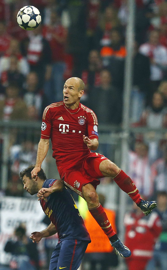 Bayern Munich's Arjen Robben (top) jumps for the ball over Barcelona's Jordi Alba during their Champions League semi-final first leg match on Tuesday