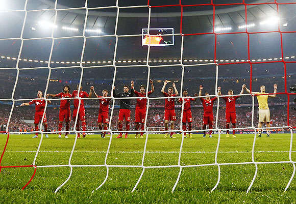 Bayern Munich's players celebrate after beating Barcelona 4-0 on Tuesday