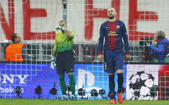Barcelona's Gerard Pique (right) and goalkeeper Victor Valdes react after Bayern Munich's Mario Gomez scored on Tuesday