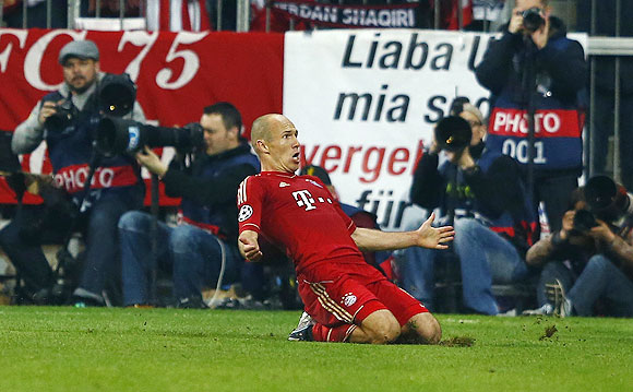 Arjen Robben celebrates after scoring against Barcelona